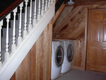 Laundry area under stairs